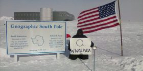 QAnon Supporter with WWG1WGA Sign at South Pole, Antarctica